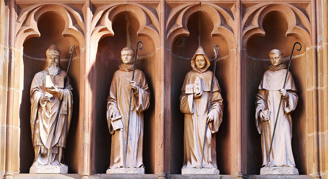 statues on the exterior of a church showing Catholic saints